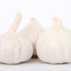 Garlic cloves, macro close up isolated on white, close-up, with copy space